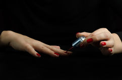 Hands of Young Woman Making Manicure Stock Image
