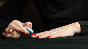 Hands of Young Woman Making Manicure Stock Photography