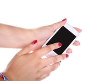 Hands of a young woman and a mobile phone Royalty Free Stock Photos