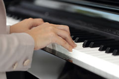 Hands of a young woman playing piano Stock Photography