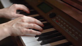 Hands of young woman playing piano stock video footage