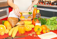 Hands of a young woman preparing school lunch box. Stock Photography