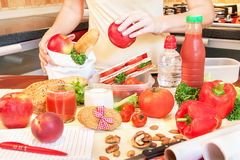 Hands of a young woman preparing school lunch box. Royalty Free Stock Images