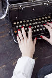 Hands of a young woman printed on a typewriter Royalty Free Stock Photos