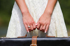 Hands of a  woman with a suitcase Royalty Free Stock Photo