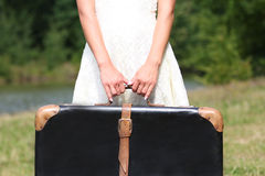 Hands of a  woman with a suitcase Royalty Free Stock Photography