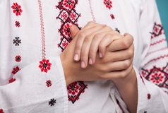 Hands of a young woman in the Ukrainian national clothes Royalty Free Stock Photos