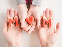 Hands of a younger daughter and her mother`s royalty free stock photography