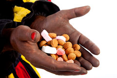 Hands of Zwarte piet ( black pete) with pepernoten Stock Photography