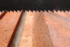 Handsaw above lumbers Stock Photography