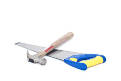 Handsaw and hammer on white background Stock Photography