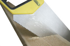 Handsaw in wood Royalty Free Stock Photos