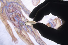 Handschattenbild mit Pille Stockbilder