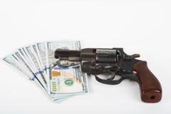 Handschellen, Geld und Gewehr Lizenzfreies Stockbild