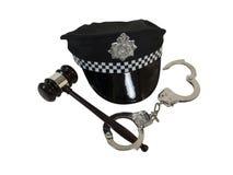 Handschellen Hammer und Polizei-Hut Stockfoto