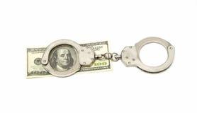 Handschellen mit Dollarbanknote Stockbilder
