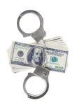 Handschellen und Dollar lokalisiert Stockfoto
