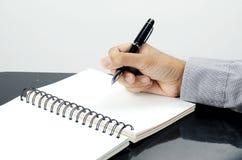 Handschrift auf Buch und Stockbilder