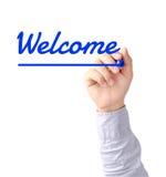 Handschrift-Willkommen mit blauer Markierung auf transparentem Brett Stockfotografie