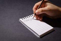 Handschriftmitteilung auf dem Weißbuch lizenzfreie stockfotografie