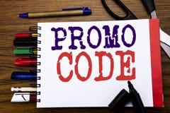Handschrifts-Mitteilungstext, der Promo-Code zeigt Geschäftskonzept für Förderung für das on-line-Geschäft geschrieben auf Notizb Lizenzfreie Stockfotografie