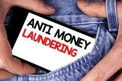 Handschriftstext, der Anti-Monay Laundring schreibt Hereinkommende Projekte der Konzeptbedeutung, zum des weg schmutzigen Geldes  stockbild