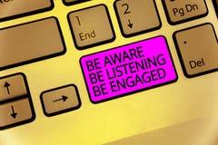 Handschriftstext ist hört wird engagiert bewusst Die Konzeptbedeutung nehmen Aufmerksamkeit Aktionen oder Sprecher zum Tastaturpu lizenzfreies stockfoto