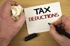 Handschriftstext Steuerabzüge Konzeptbedeutung Reduzierung auf Steuern Wertpapiersparen-Geld bringt das kein Weißbuch der Wörter  Lizenzfreie Stockfotografie