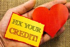 Handschriftstext-Vertretung Verlegenheit Ihr Kredit Geschäftskonzept für das schlechte Ergebnis, das Avice Fix Improvement Repair lizenzfreie stockfotos