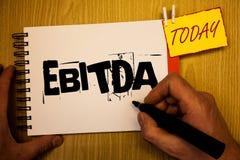 Handschrifttekst die Ebitda schrijven Concept die Inkomens betekenen vóór van de de Waardeverminderingsamortisatie van Rentebelas stock afbeeldingen