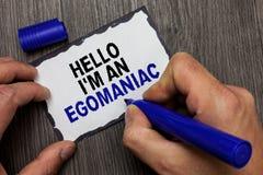 Handschrifttekst Hello ben ik een Egomaniac Concept die de Egoïstische Egocentrische Narcissist zelf-Gecentreerde hand van het Eg stock afbeelding