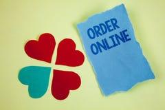 Handschrifttekst het schrijven Orde online Concept die Aankoop betekenen iets op Internet-Elektronische handel het Draadloze wink stock foto