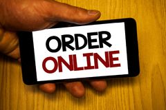 Handschrifttekst het schrijven Orde online Concept die Aankoop betekenen iets op Internet-Elektronische handel het Draadloze wink royalty-vrije stock afbeelding