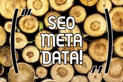 Handschrifttekst Seo Meta Data Concept die Zoekmachineoptimalisering Online marketing strategie Houten achtergrond betekenen royalty-vrije stock afbeelding