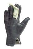 Handschuh mit Dollar Stockfoto