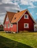 Handschuh-Rand - rotes Haus lizenzfreies stockbild