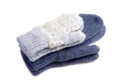 Handschuhe getrennt auf weißem Hintergrund Stockfotos