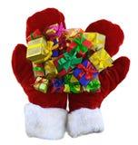 Handschuhe mit Stapel von Geschenken 1 Lizenzfreies Stockfoto