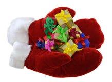 Handschuhe mit Stapel von Geschenken 2 Lizenzfreie Stockfotos