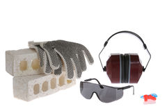 Handschuhe, Sicherheitsgläser, Ohr-Muffen und Ohr-Bolzen Stockfotos