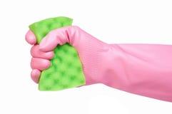 Handschuhholdingschwamm getrennt auf Weiß Lizenzfreies Stockfoto