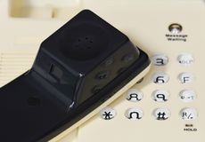 Handset on button desktop phone Stock Images