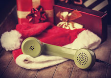 Handset and christmas gifts Stock Images