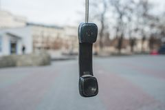 The handset hangs on a wire Stock Photos