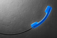 Handset from landline phone on  background wall Royalty Free Stock Image