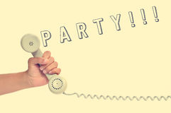 Handset of a retro telephone and word party, with a retro effect Royalty Free Stock Image