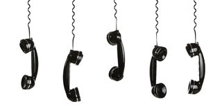 Handsets hanging in the row Stock Photos