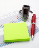 Handsfree, notes and pen on earnings chart background Royalty Free Stock Images