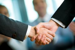 Handshake. Photo of handshake of business partners after striking deal Stock Photos