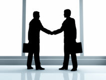 Handshake. Two businessmen handshake standing on the road Stock Images